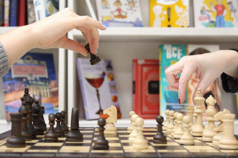 two player of chess, one making a move