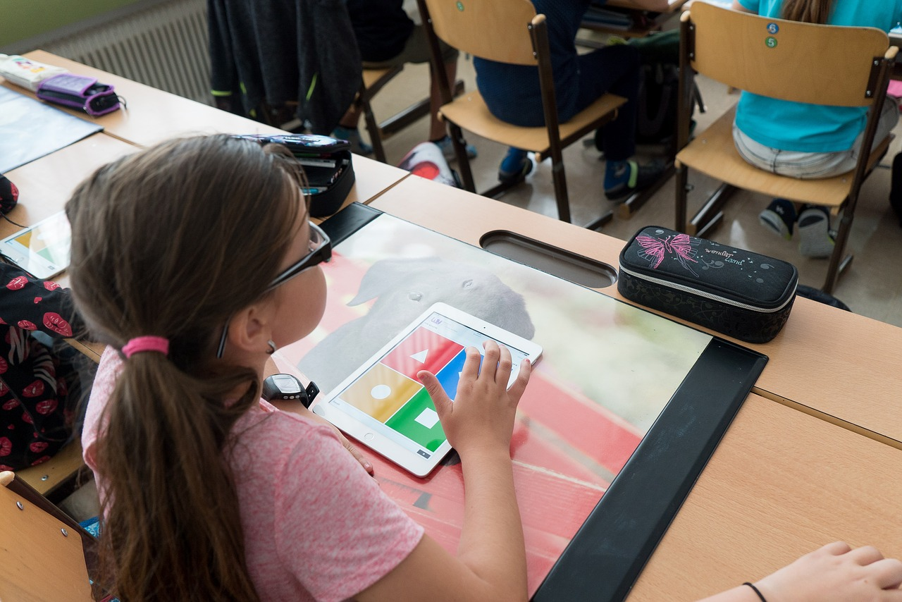girl learning with ipad in class