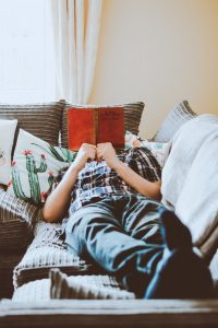 Man on couch reading